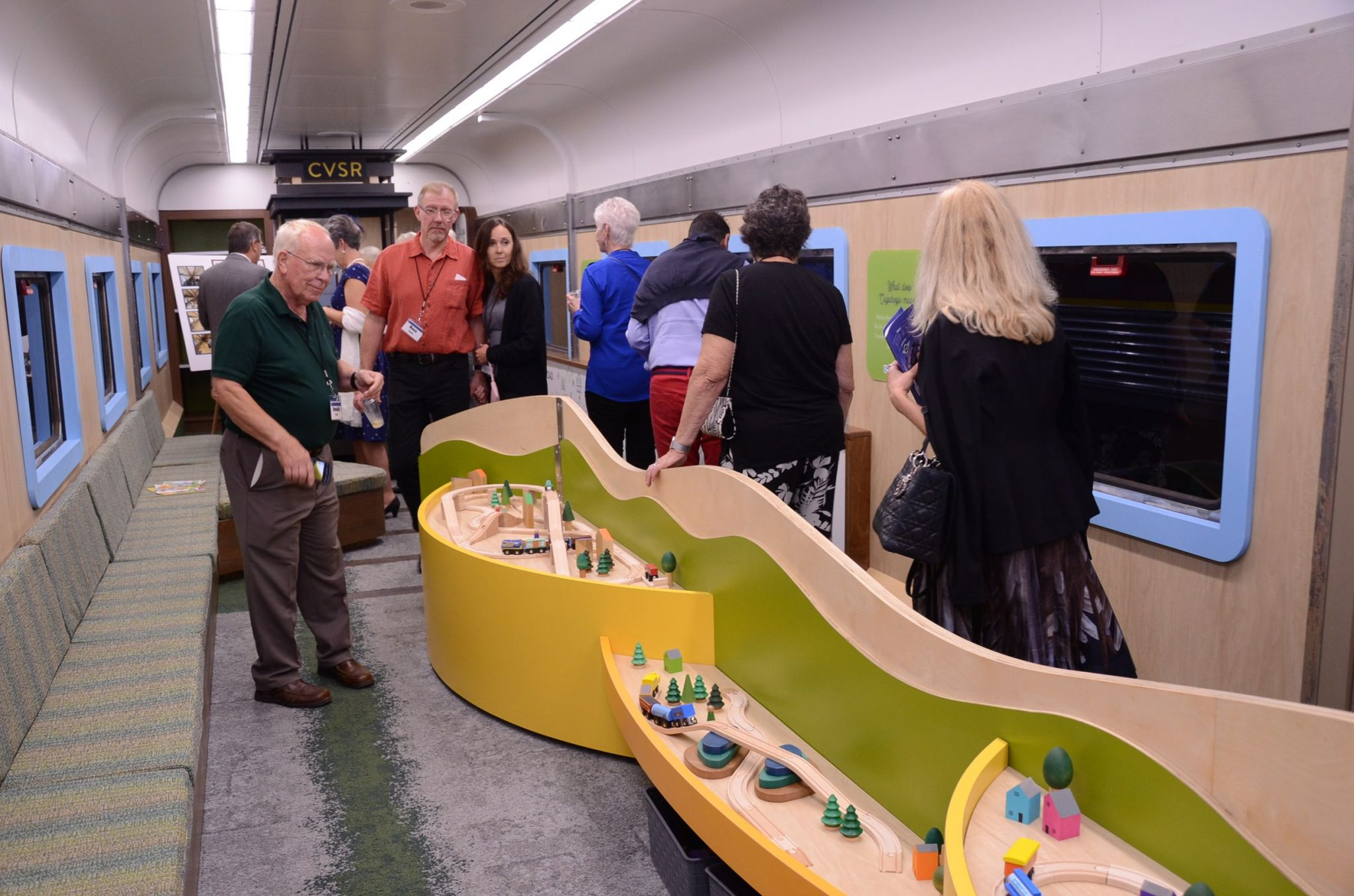 guests view the edu-trainment car with train sets and interactive exhibits.