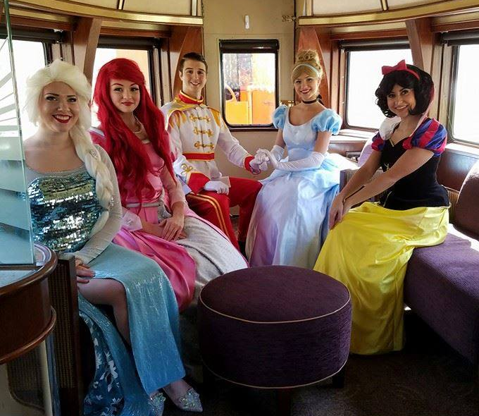 ice queen, little mermaid, sea prince, cinderella and snow sitting in the saint lucie lounge car